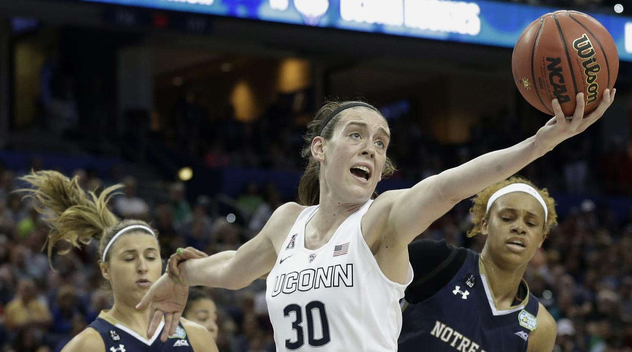 FILE - In this April 7, 2015, file photo, Connecticut forward Breanna Stewart (30) recovers a rebound as Notre Dame guard Hannah Huffman (24) and forward Brianna Turner (11) look on during the second half of the NCAA women's Final Four tournament college