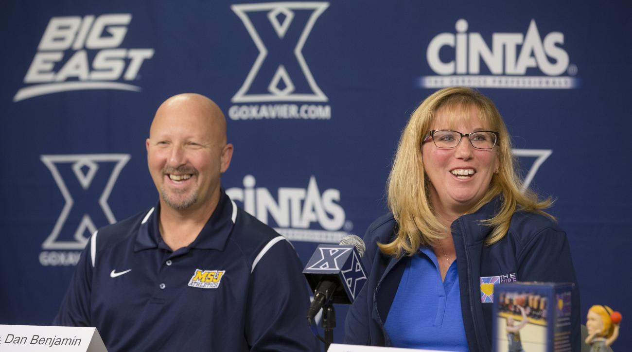 Lisa Hill, right, mother of Lauren Hill, smiles alongside Mount Saint Joseph's women's basketball head coach Dan Benjamin during a news conference at the Cintas Center to discuss the Lauren Hill Tipoff Classic at Xavier University, Tuesday, Nov. 10, 2015,