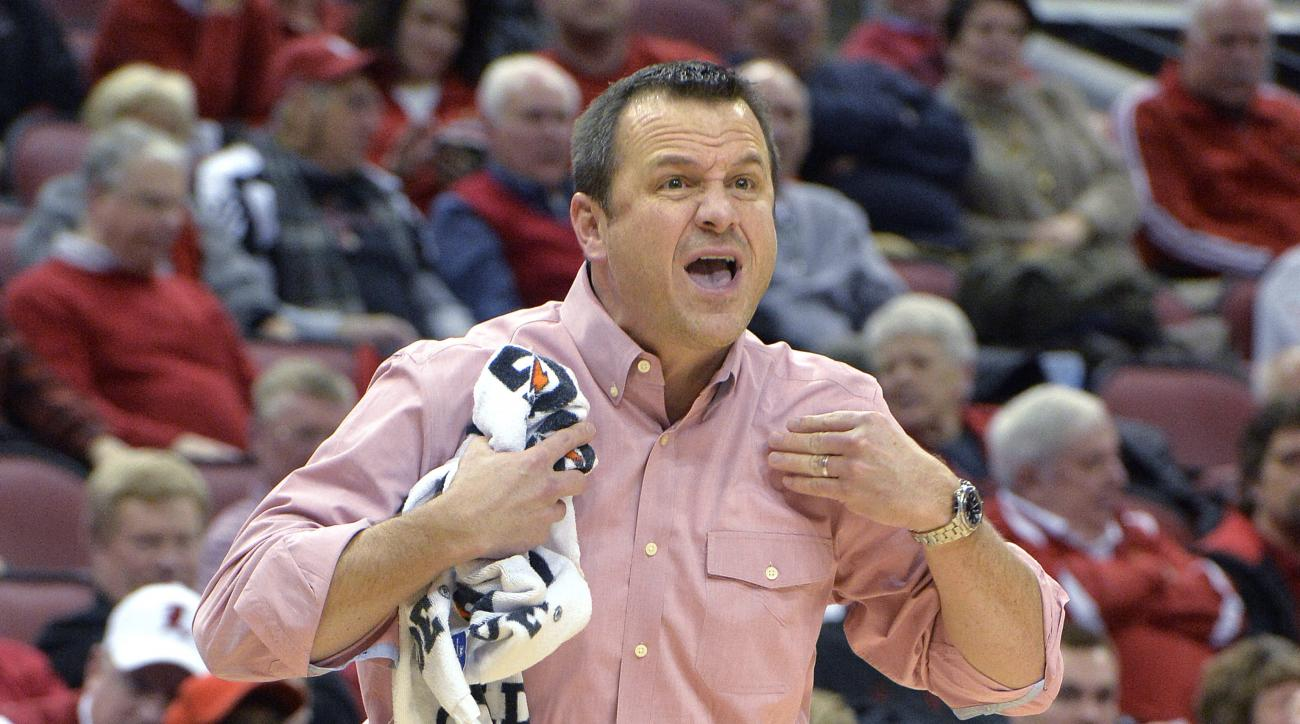 "FILE - In this Jan. 29, 2015, file photo, Louisville coach Jeff Walz shouts instructions to his team during an NCAA college basketball game against Syracuse in Louisville, Ky. ""Top to bottom, it's (the ACC) the best league in women's basketball,"" Walz sai"