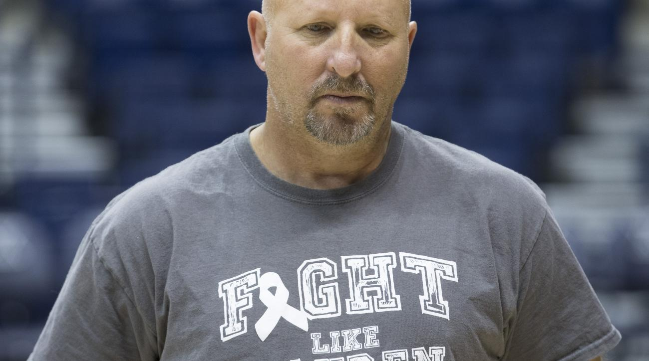 Dan Benjamin, head coach of women's basketball at Mount Saint Joseph University, pauses during practice while wearing a shirt honoring Lauren Hill at Xavier University, Friday, Nov. 13, 2015, in Cincinnati. Hill inspired millions last season by choosing t