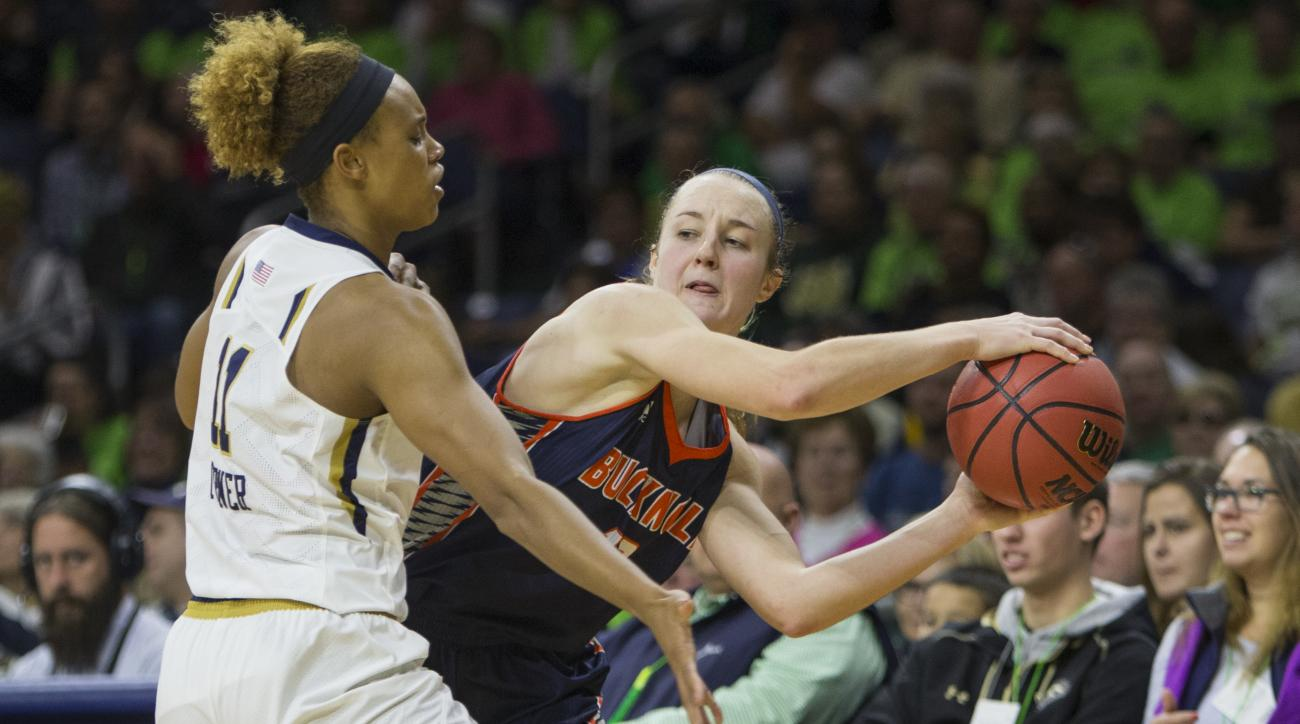 Bucknell's Claire DeBoer, front right, passes around Notre Dame's Brianna Turner (11) in the first half of an NCAA college basketball game Sunday, Nov. 15, 2015, in South Bend, Ind. (AP Photo/Robert Franklin)