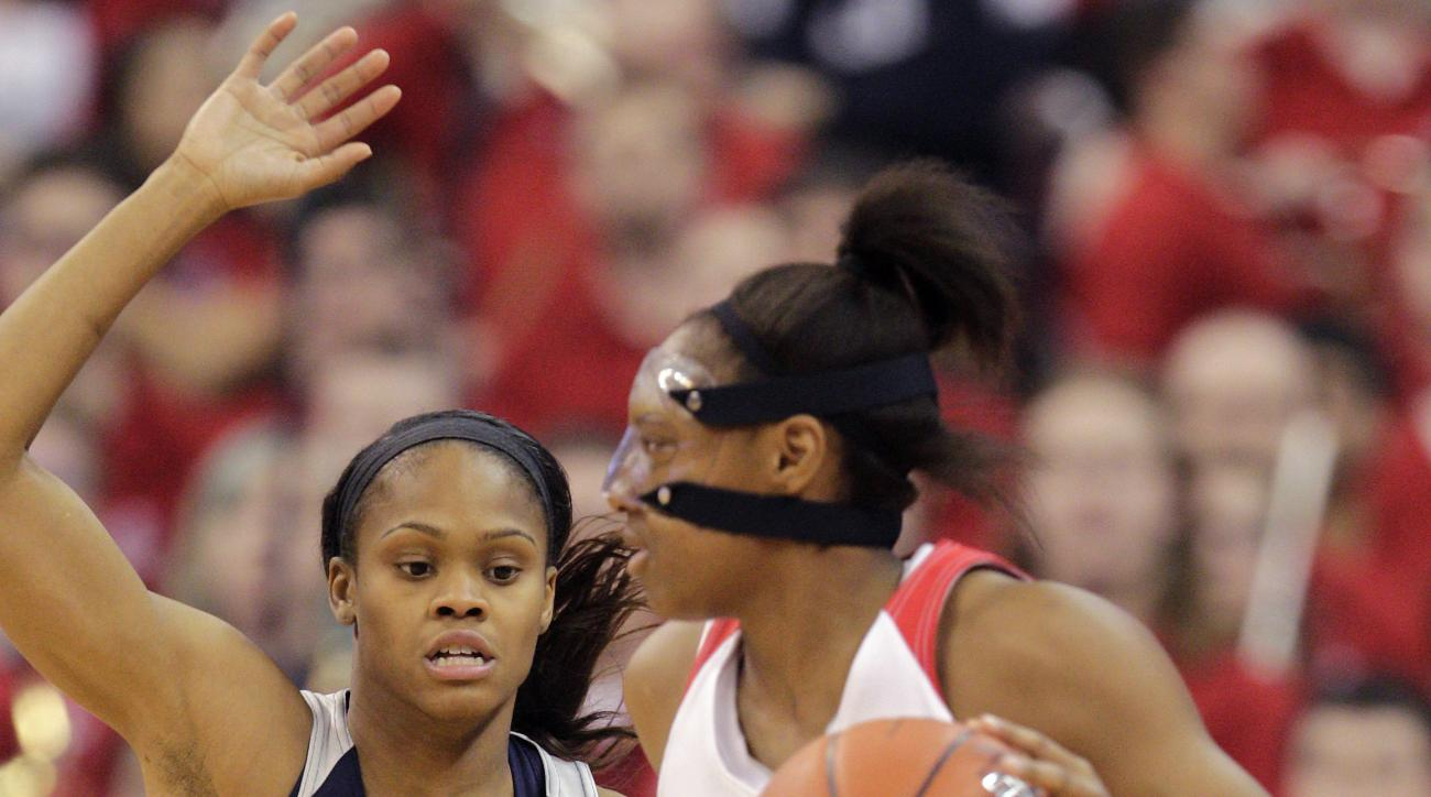 Ohio State's Kelsey Mitchell, right, looks for an open pass as Connecticut's Moriah Jefferson defends during the first quarter of an NCAA college basketball game Monday, Nov. 16, 2015, in Columbus, Ohio. (AP Photo/Jay LaPrete)