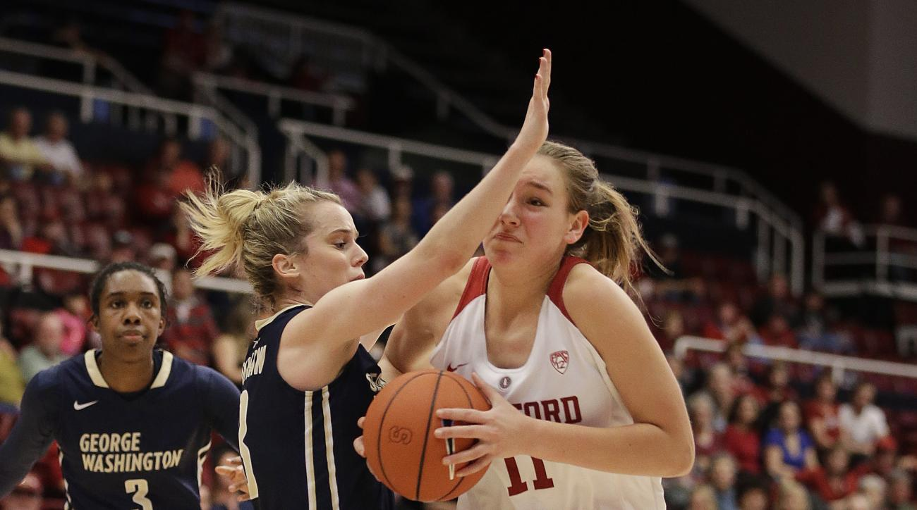 Stanford's Alanna Smith, right, drives the ball against George Washington's Shannon Cranshaw during the second half of an NCAA college basketball game Saturday, Nov. 21, 2015, in Stanford, Calif. (AP Photo/Ben Margot)