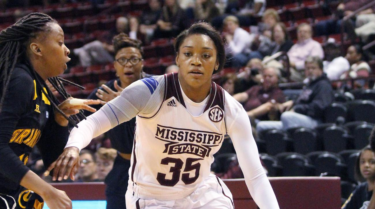 Mississippi State forward Victoria Vivians (35) drives to the basket against Grambling State guard Takerra Parsons (20) during the first half of an NCAA college basketball game in Starkville, Miss., Saturday, Nov. 21, 2015. Mississippi St. won 107- 43.(AP