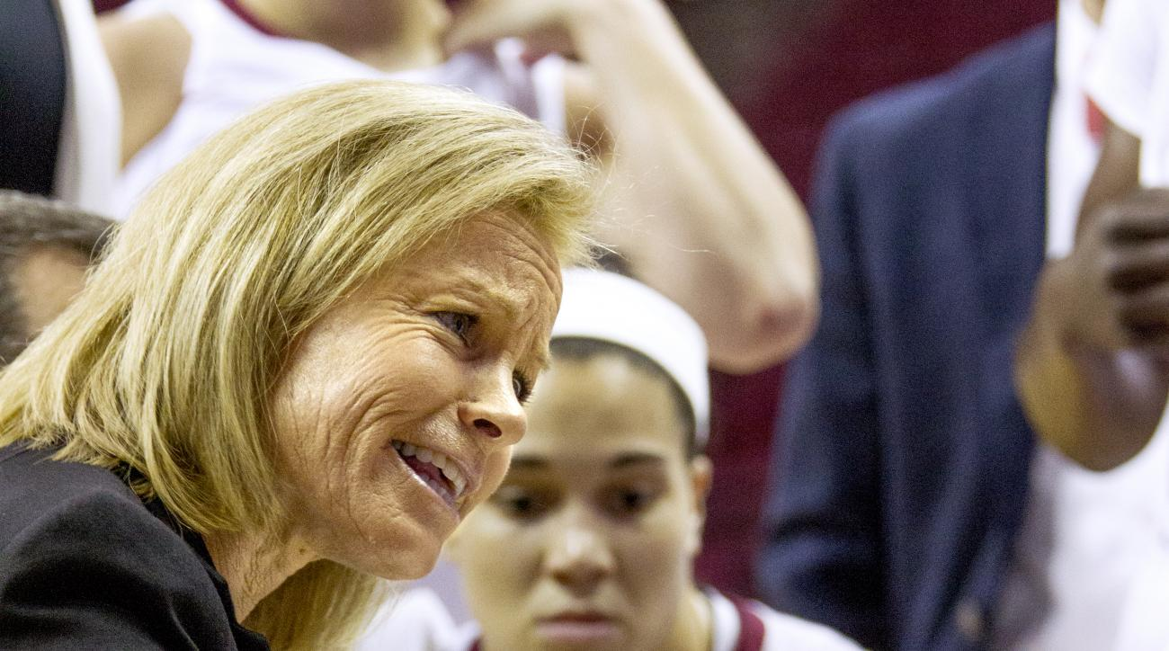 Florida State head coach Sue Semrau, left, talks to her team during a timeout in the first half of an NCAA college basketball game against UAB in Tallahassee, Fla., Sunday, Nov. 22, 2015. (AP Photo/Mark Wallheiser)