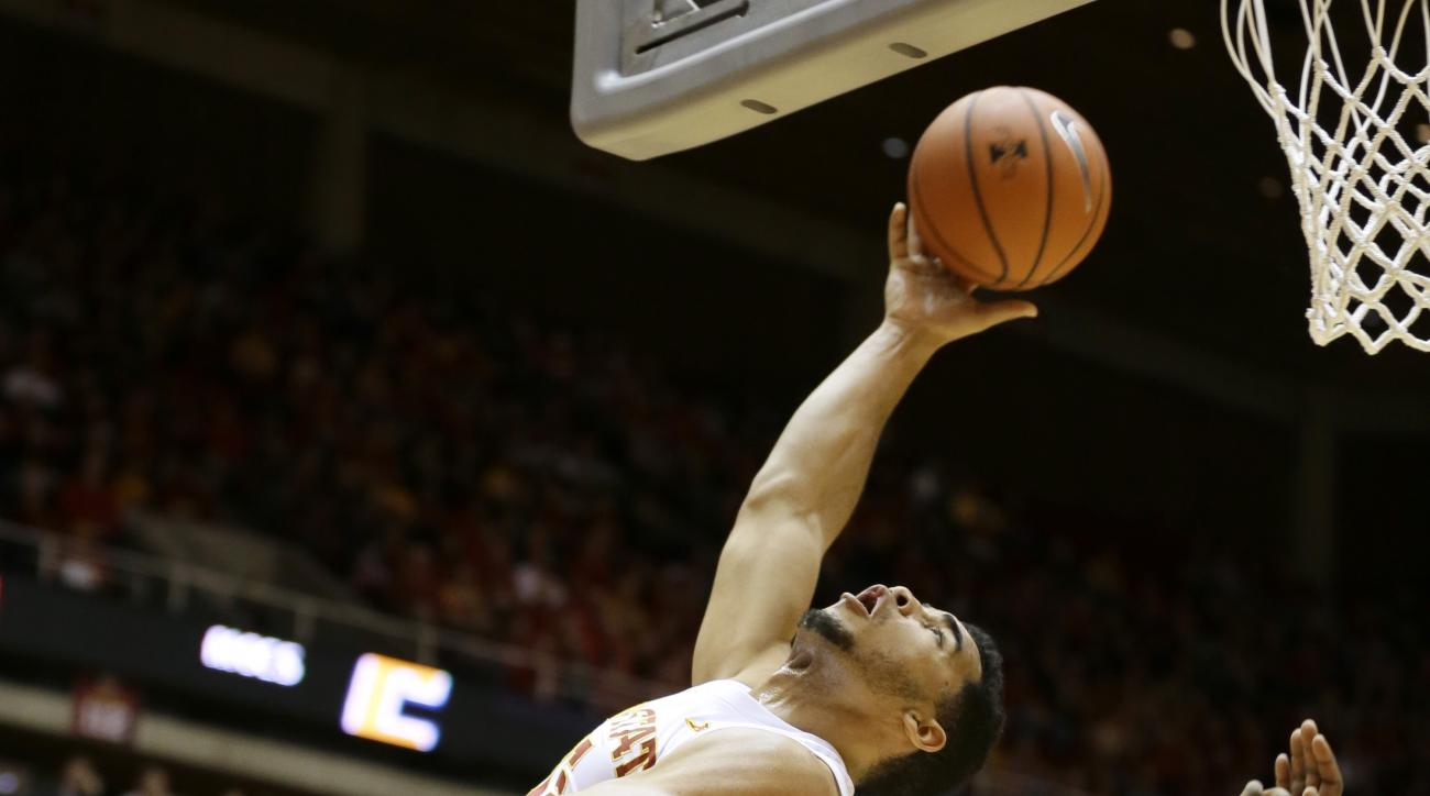 Iowa State guard Naz Mitrou-Long drives to the basket past Chattanooga forward Duke Ethridge, right, during the first half of an NCAA college basketball game, Monday, Nov. 23, 2015, in Ames, Iowa. (AP Photo/Charlie Neibergall)