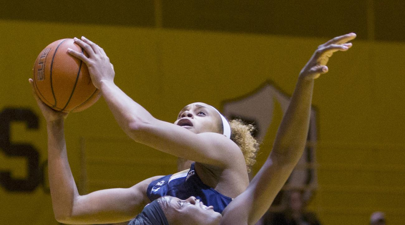 Notre Dame's Brianna Turner (11) goes up for a shot over Valparaiso's Jasmyn Walker (34) in the first half of an NCAA college basketball game, Monday, Nov. 23, 2015, in Valparaiso, Ind.  (AP Photo/Robert Franklin)
