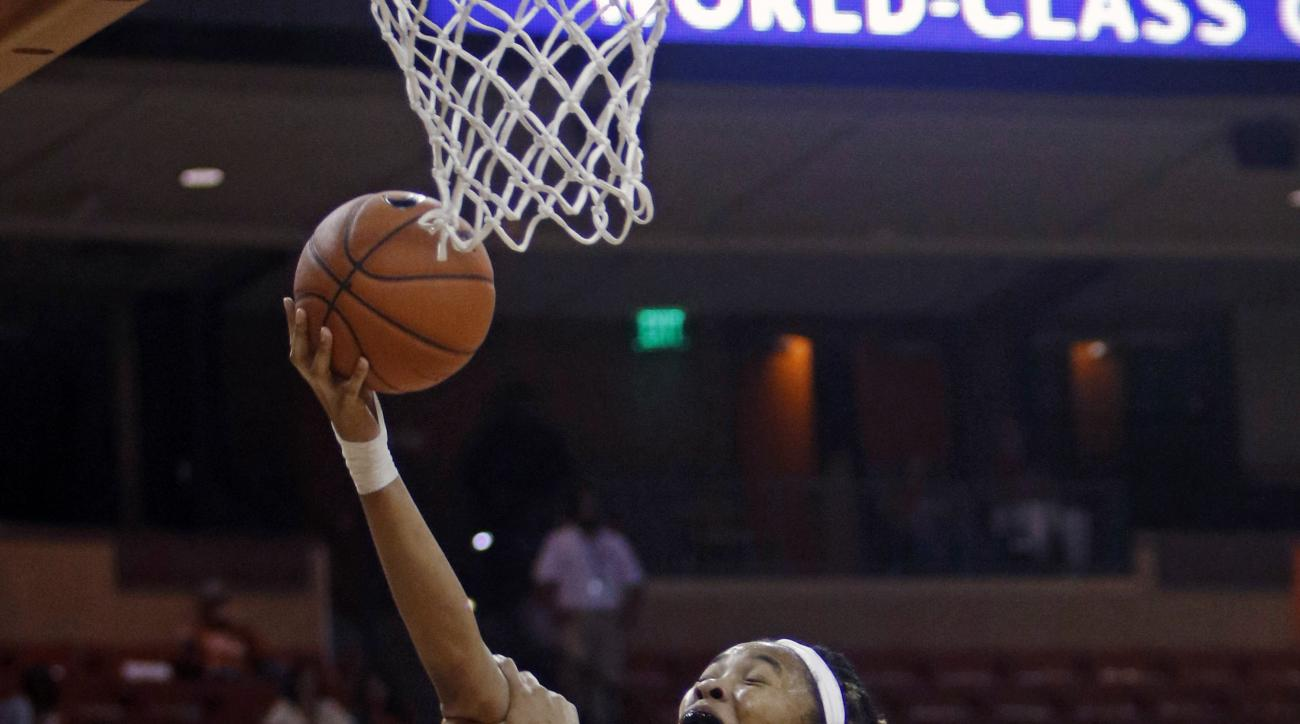 Texas center Imani Boyette shoots against Hampton forward Mikayla Sayle, during the second half of an NCAA college basketball game Wednesday, Nov. 25, 2015, in Austin, Texas. Texas won 79-52. (AP Photo/Michael Thomas)