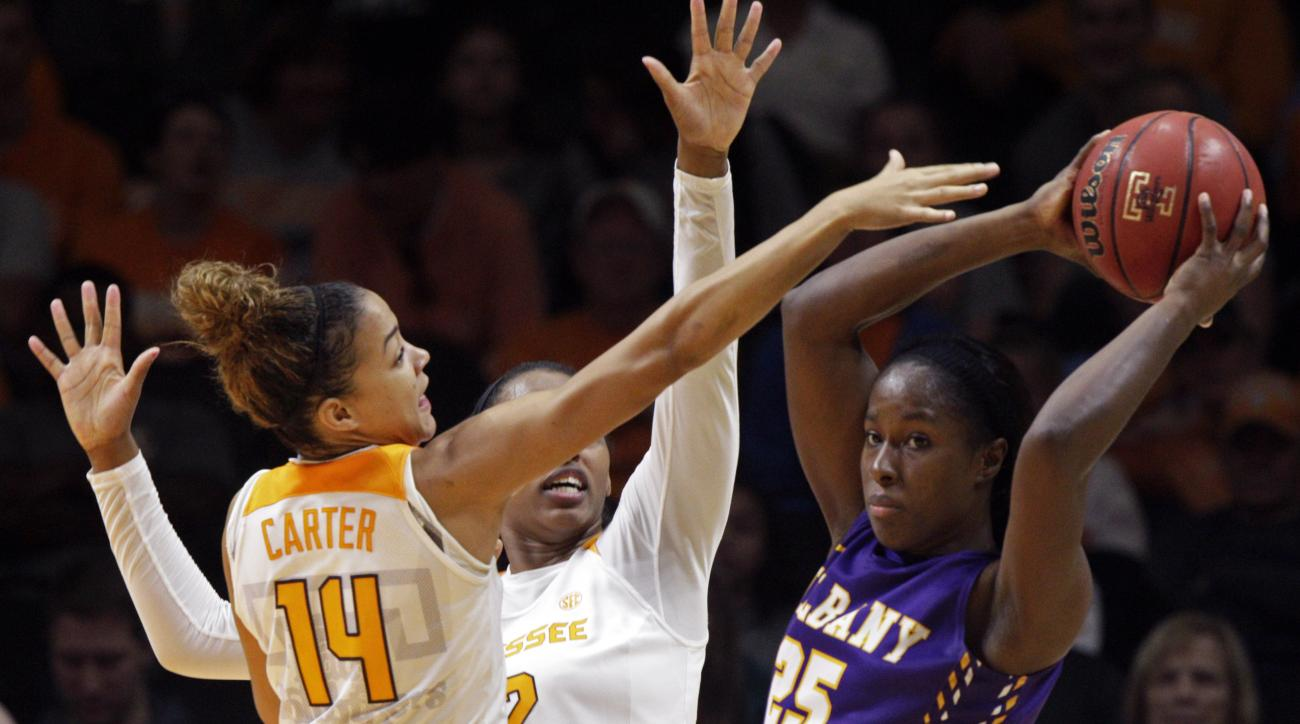 Albany forward Shereesha Richards (25) looks for help as she's pressured by Tennessee guard Andraya Carter (14) and forward Bashaara Graves (12) in the second first half of an NCAA college basketball game Friday, Nov. 27, 2015, in Knoxville, Tenn. Tenness