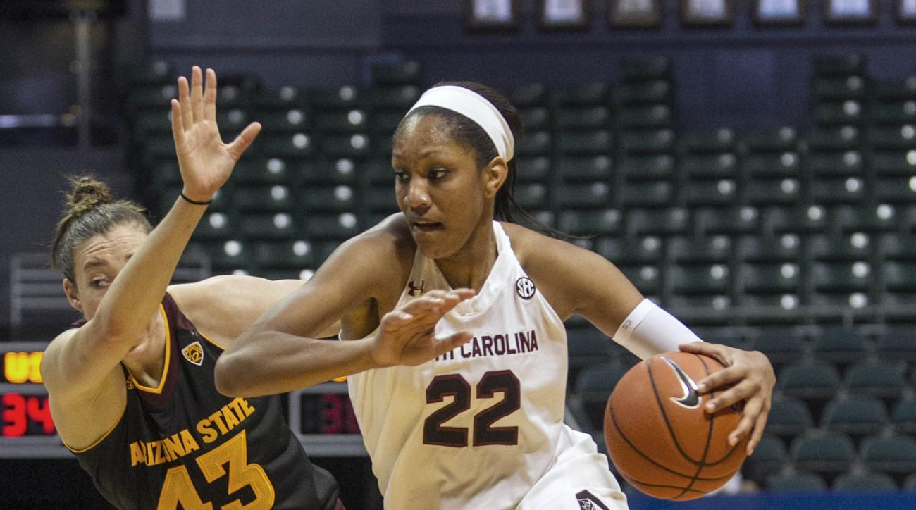 South Carolina forward A'ja Wilson, right, dribbles past Arizona forward Eliza Normen during the second half of an NCAA college basketball game, Friday, Nov. 27, 2015 in Honolulu.    (AP Photo/Marco Garcia)