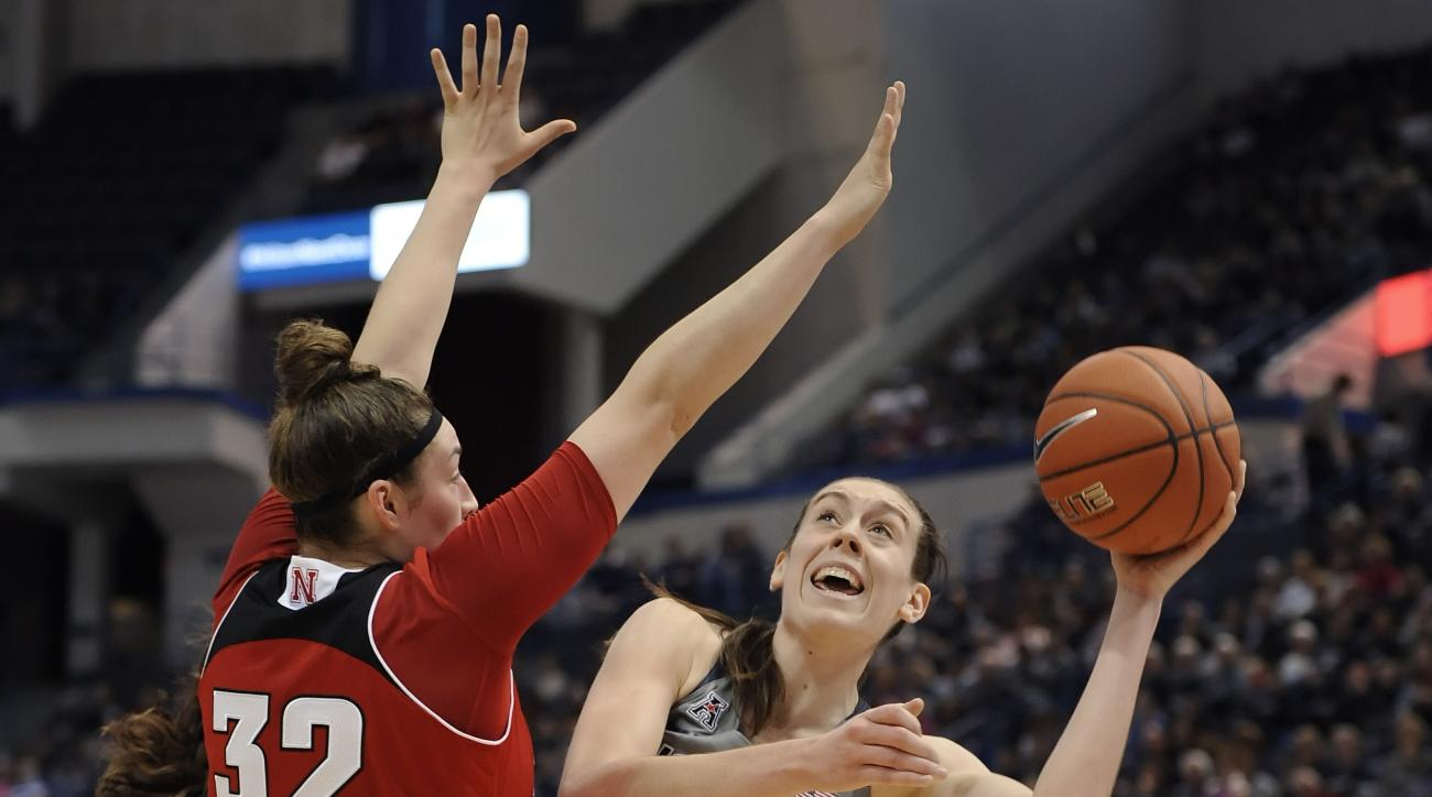 Connecticut's Breanna Stewart, right, shoots around Nebraska's Jessica Shepard, left, during the first half of an NCAA college basketball game, Saturday, Nov. 28, 2015, in Hartford, Conn. (AP Photo/Jessica Hill)