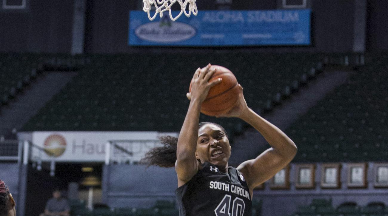 South Carolina Jatarie White grabs a rebound against Cal State Bakersfield during the first half of an NCAA college basketball game Saturday, Nov. 28, 2015, in Honolulu. (AP Photo/Marco Garcia)