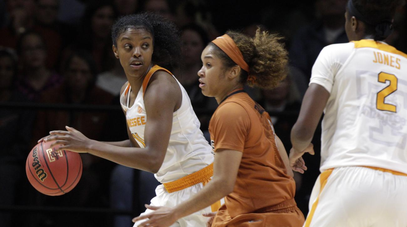 Tennessee guard Diamond DeShields (11) looks to pass as she's defended by Texas guard Empress Davenport (1) in the first first half of an NCAA college basketball game, Sunday, Nov. 29, 2015, in Knoxville, Tenn. Tennessee won 63-55. (AP Photo/Wade Payne)