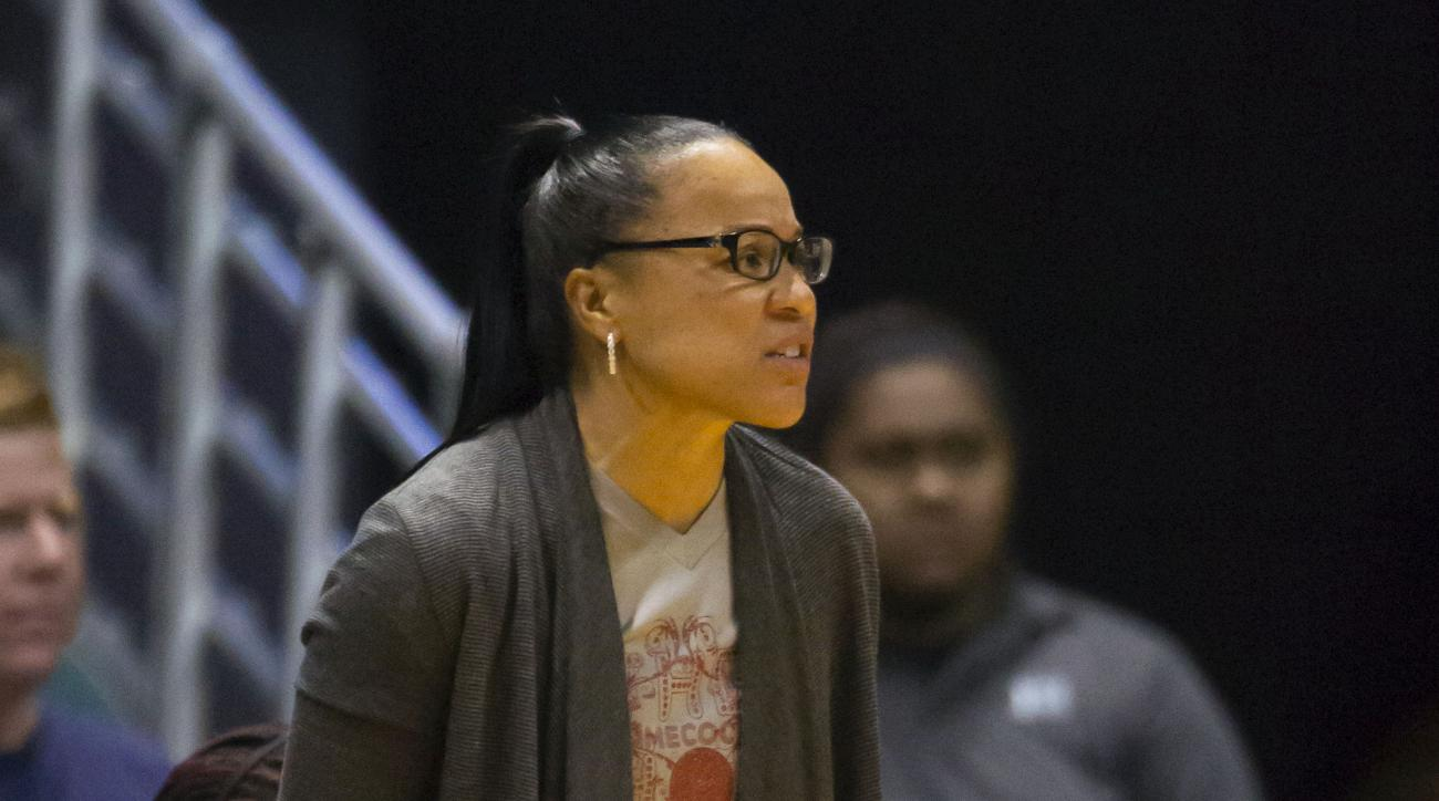 South Carolina head coach Dawn Staley watches her team play Hawaii in the first half of an NCAA college basketball game Sunday, Nov. 29, 2015, in Honolulu. (AP Photo/Eugene Tanner)