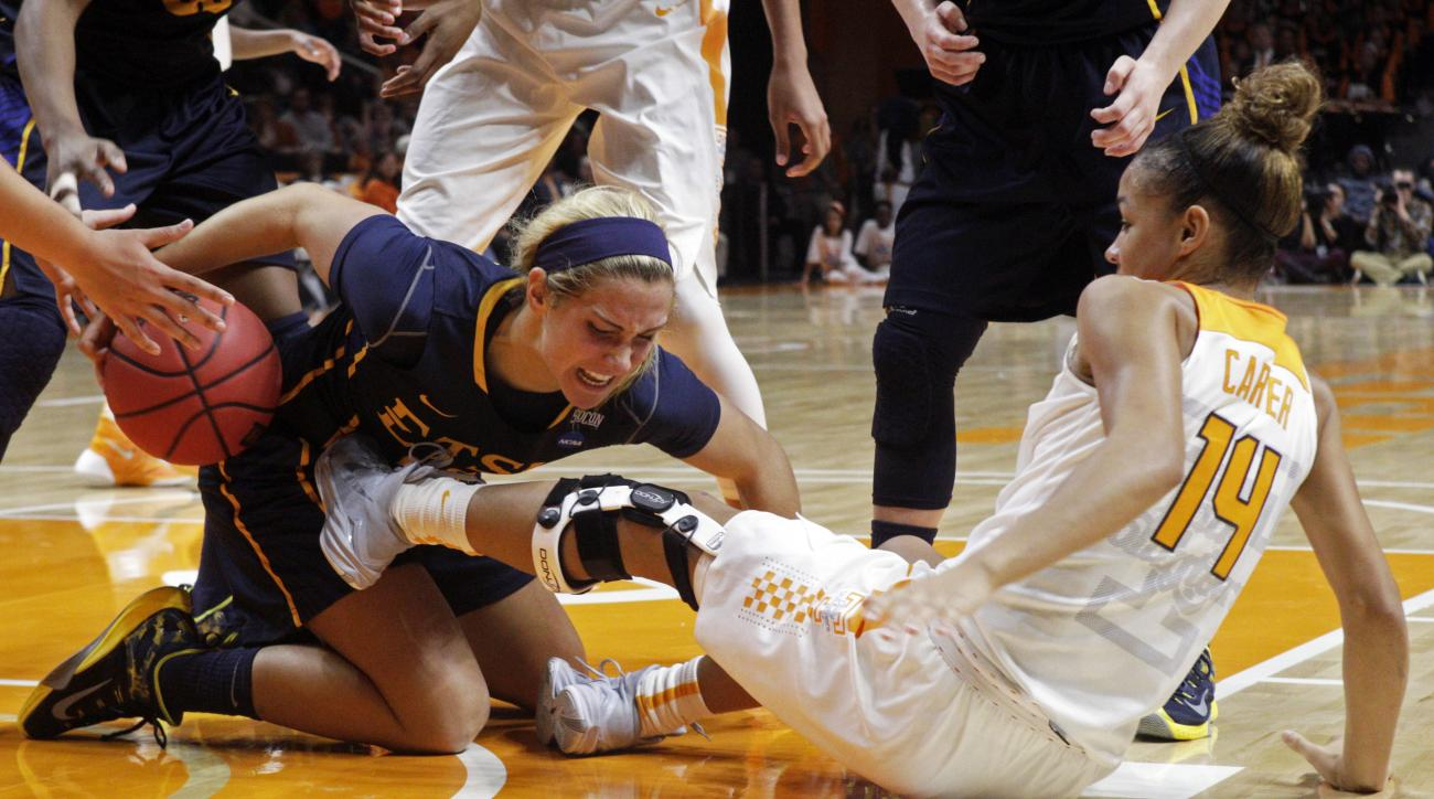 East Tennessee State guard Malloree Schurr, left, keeps the ball away from Tennessee guard Andraya Carter (14) in the first half of an NCAA college basketball game Wednesday, Dec. 2, 2015, in Knoxville, Tenn. (AP Photo/Wade Payne)