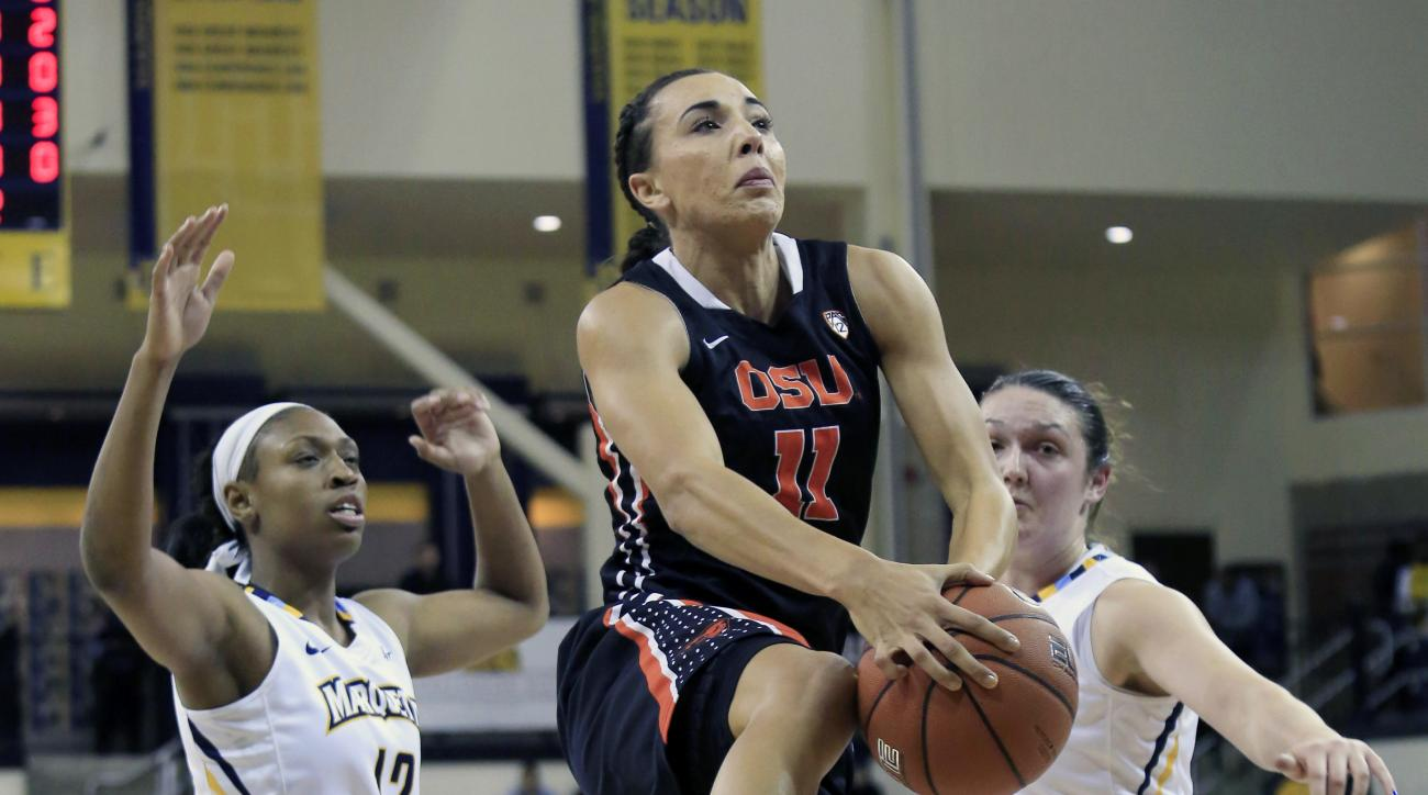 Oregon State's Katie McWilliams, center, goes up for a basket against Marquette during the first half of an NCAA basketball game Thursday, Dec. 3, 2015, in Milwaukee. (AP Photo/Darren Hauck)