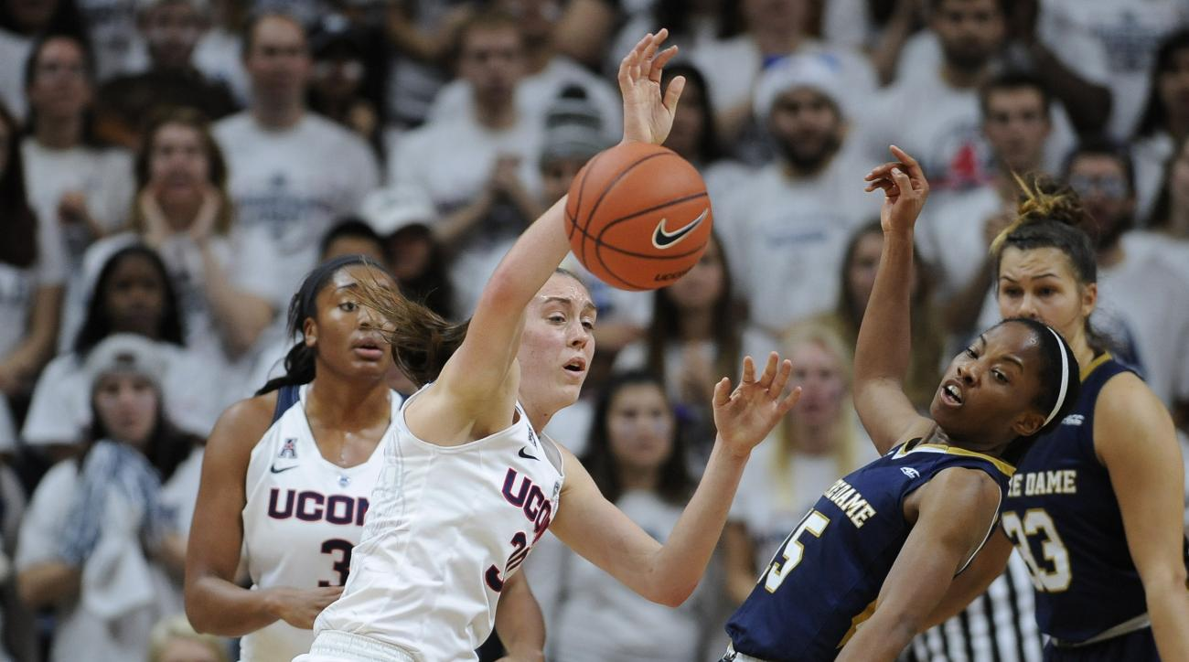 Connecticut's Breanna Stewart, left, and Notre Dame's Lindsay Allen, right, collide during the first half of an NCAA college basketball game, Saturday, Dec. 5, 2015, in Storrs, Conn. (AP Photo/Jessica Hill)
