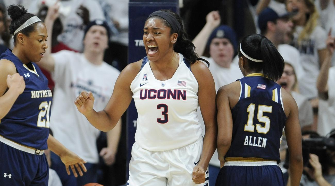 Connecticut's Morgan Tuck reacts after making a basket and being fouled during the first half of an NCAA college basketball game against Notre Dame, Saturday, Dec. 5, 2015, in Storrs, Conn. (AP Photo/Jessica Hill)