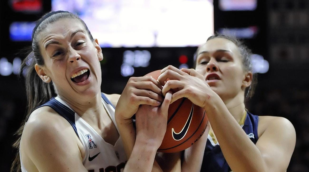 Connecticut's Breanna Stewart, left, and Notre Dame's Kathryn Westbeld, right, fight for possession of the ball during the second half of an NCAA college basketball game, Saturday, Dec. 5, 2015, in Storrs, Conn. (AP Photo/Jessica Hill)
