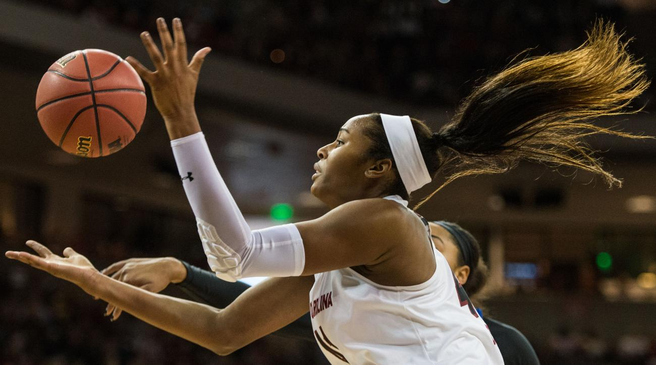 South Carolina Alaina Coates grabs a rebound against Duke during the first half of an NCAA college basketball game Sunday, Dec. 6, 2015, in Columbia, S.C. (AP Photo/Sean Rayford)
