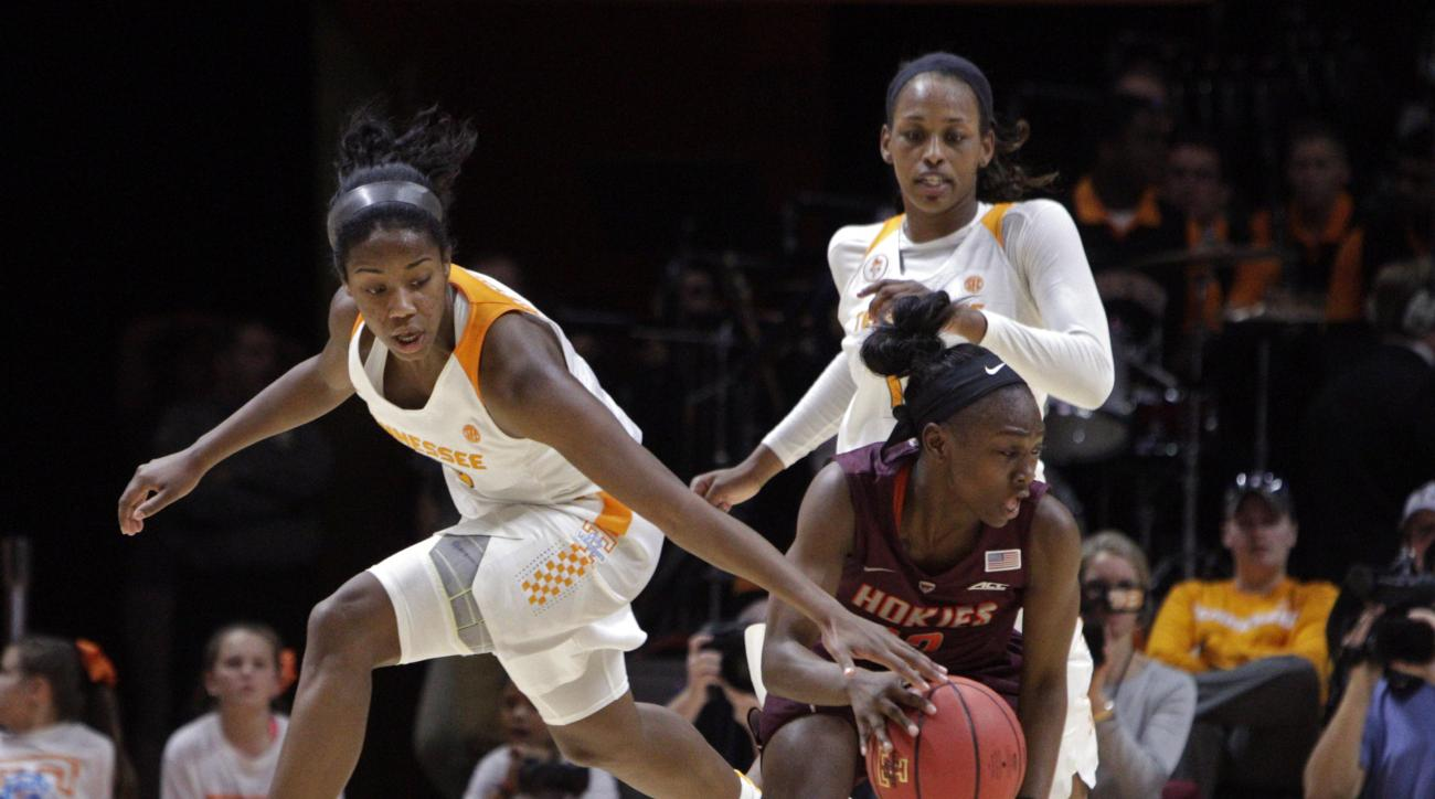 Tennessee guard Meme Jackson, left, attempts to steal the ball from Virginia Tech guard Chanette Hicks, front right, as Tennessee's Bashaara Graves, back right, looks ons in the first half of an NCAA college basketball game Sunday, Dec. 6, 2015, in Knoxvi
