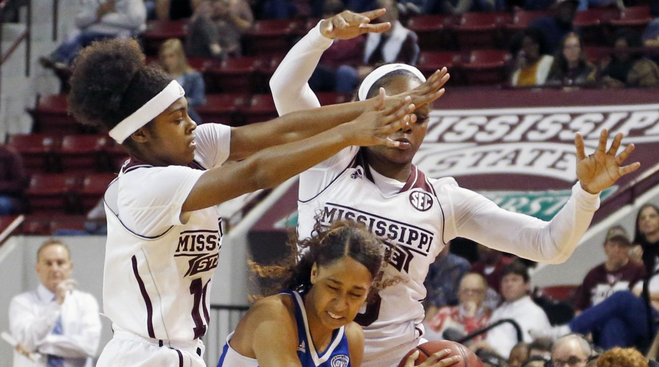 Tennessee State guard Michelle Cox (15) tries to protect the ball from Mississippi State guard Jazzmun Holmes, left, forward Sherise Williams, right, in the first half of an NCAA college basketball game in Starkville, Miss., Sunday, Dec. 6, 2015. (AP Phot