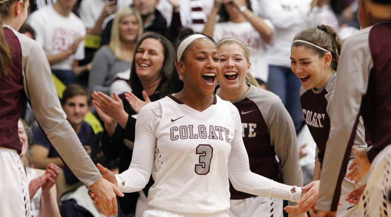 Colgate's Randyll Butler celebrates as she is introduced before an NCAA college basketball game against Connecticut in Hamilton, N.Y., Wednesday, Dec. 9, 2015. (AP Photo/Nick Lisi)