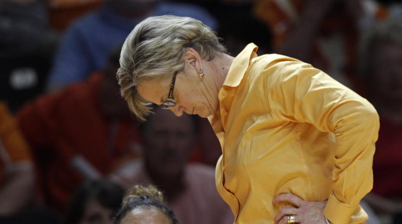 FILE - In this Dec. 6, 2015 file photo, Tennessee head coach Holly Warlick looks down in the second half of their 57-43 loss to Virginia Tech in an NCAA college basketball game in Knoxville, Tenn. With two losses in its last three games, No. 16 Tennessee