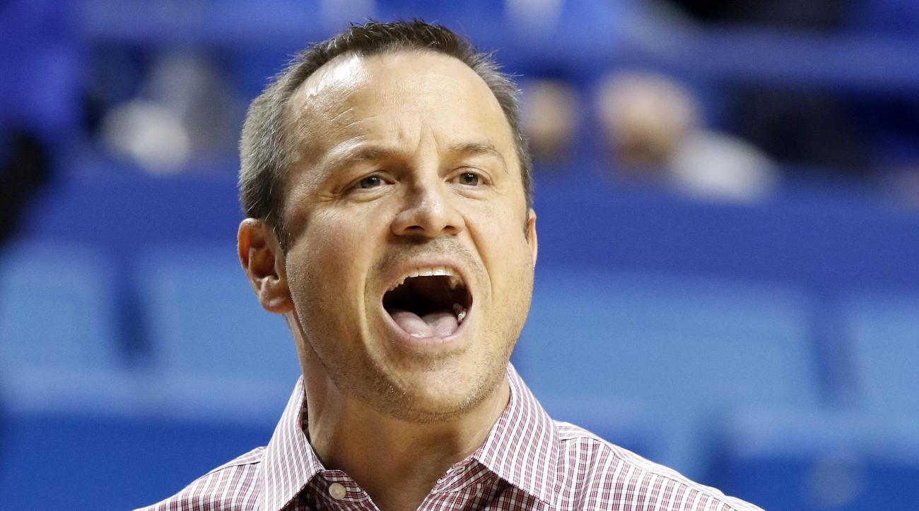 Louisville head coach Jeff Walz shouts instructions during the second quarter of an NCAA college basketball game against Kentucky Thursday, Dec. 10, 2015, in Lexington, Ky. (AP Photo/James Crisp)