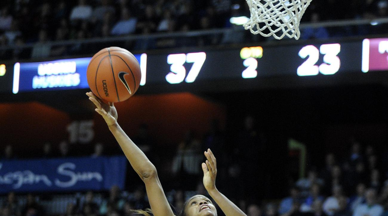 Connecticut's Moriah Jefferson (4) drives to the basket as Florida State's Audut Bulgak (2) looks on during the first half of an NCAA college basketball game in Uncasville, Conn., on Friday, Dec. 11, 2015. (AP Photo/Fred Beckham)