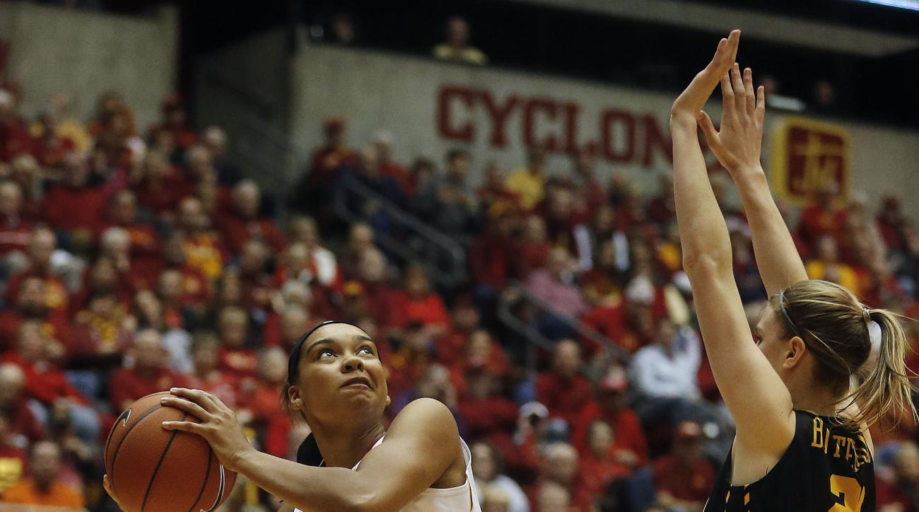 Iowa State's Meredith Burkhall goes up for a shot while being guarded by Iowa's Christina Buttenhamduring an NCAA college basketball game, Friday, Dec. 11, 2015 in Ames, Iowa. (Rachel Mummey/The Des Moines Register via AP)  MAGS OUT, TV OUT, NO SALES, MAN