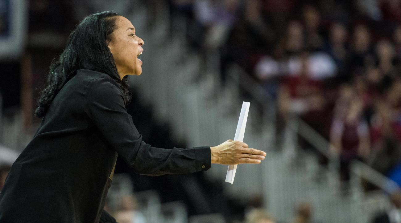 South Carolina head coach Dawn Staley communicates to her team against Winthrop during the first half of an NCAA college basketball game, Sunday, Dec. 13, 2015, in Columbia, S.C. (AP Photo/Sean Rayford)