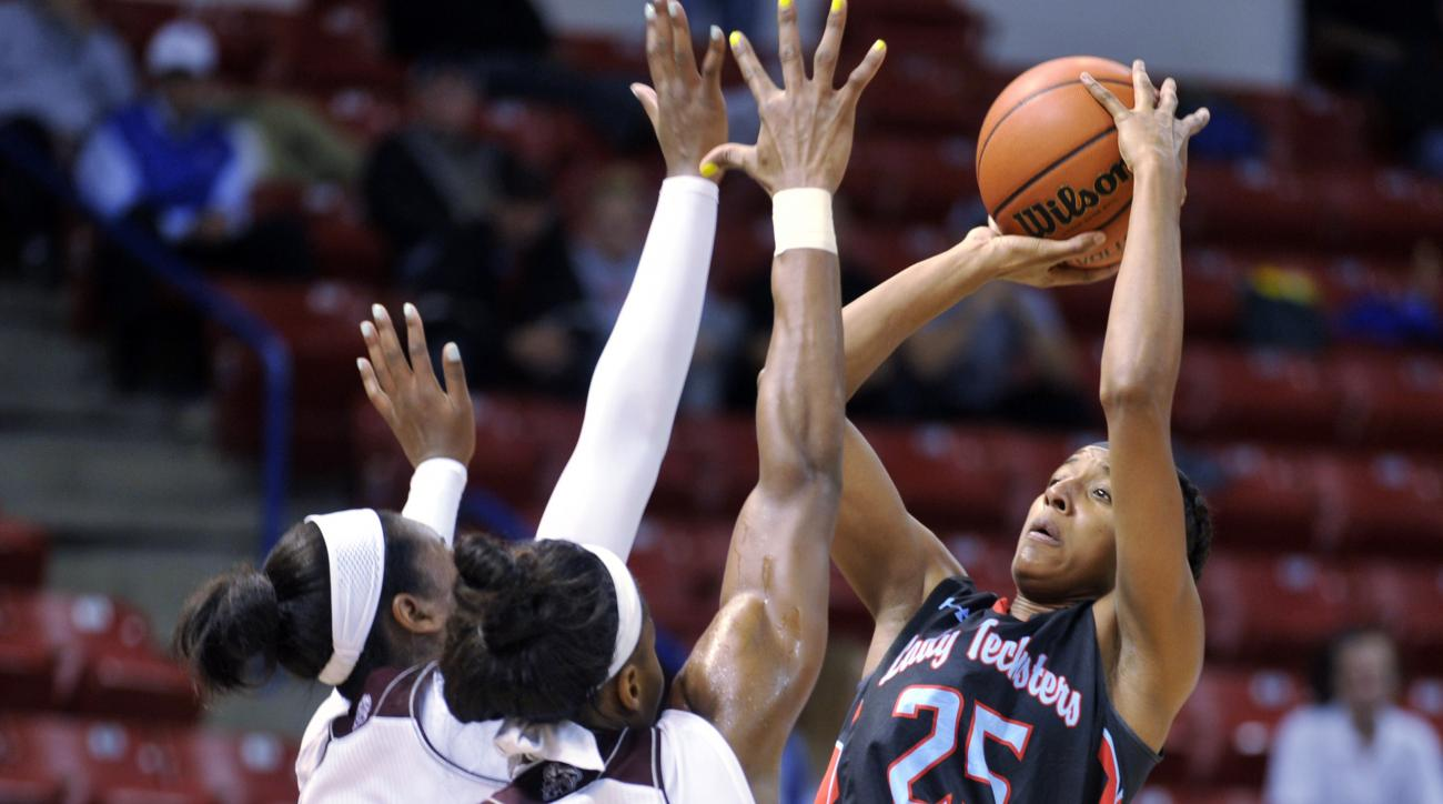 Louisiana Tech guard/forward Brandi Wingate (25) shoots against Mississippi State center Chinwe Okorie (45) during the first half of their NCAA college basketball game in Ruston, La., Sunday, Dec. 13, 2015. (AP Photo/Kita Wright)