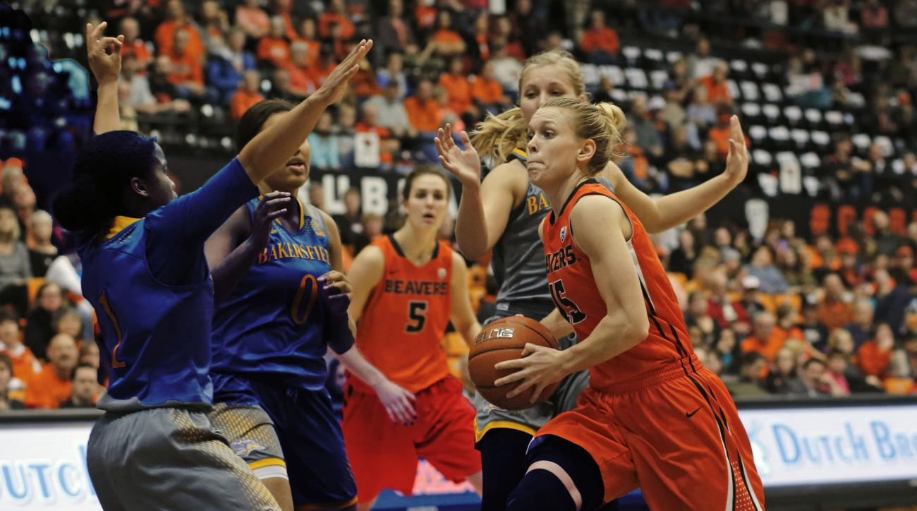 Oregon State's Jamie Weisner, right, drives to the basket during Oregon State's 75-51 win over CSU Bakersfield in an NCAA college basketball game, in Corvallis, Ore., on Tuesday, Dec. 15, 2015. (AP Photo/Timothy J. Gonzalez)