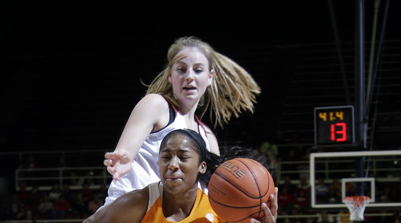 Tennessee guard Te'a Cooper (20) dribbles past Stanford guard Karlie Samuelson during the first half of an NCAA college basketball game Wednesday, Dec. 16, 2015, in Stanford, Calif.  (AP Photo/Marcio Jose Sanchez)