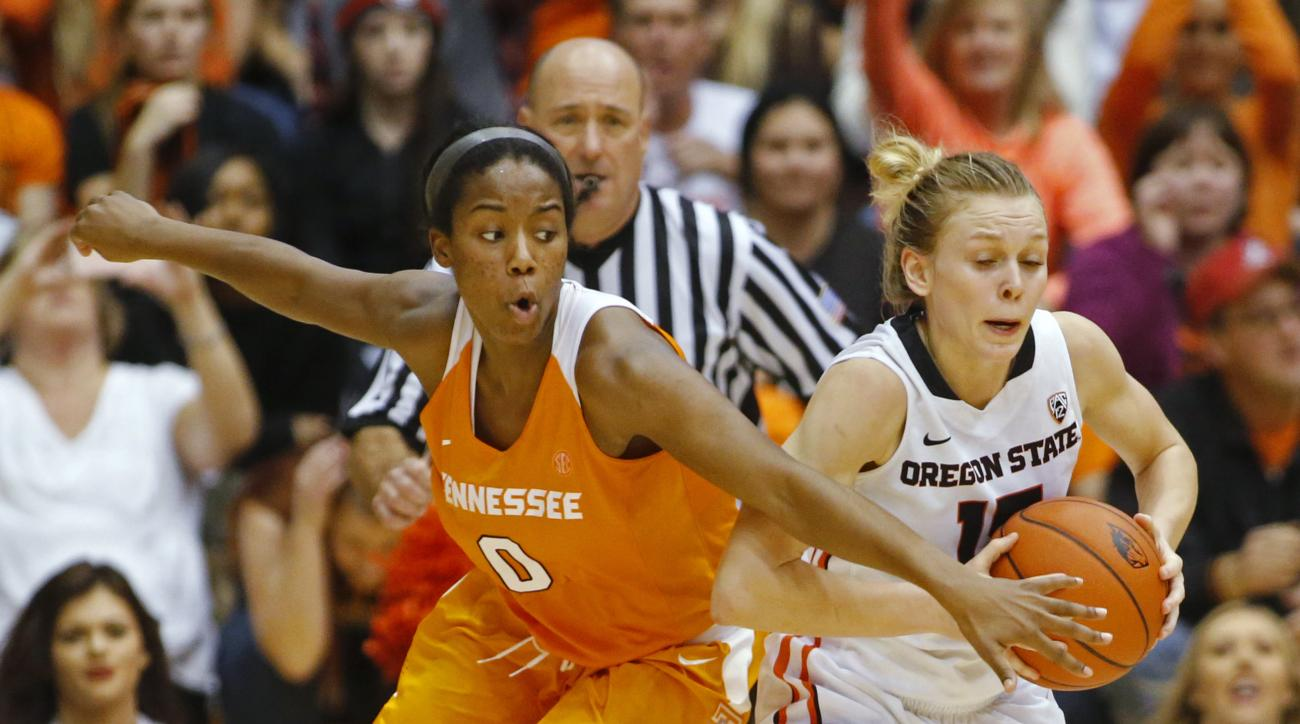 Oregon State's Jamie Weisner, right, protects the ball from Tennessee's Jordan Reynolds during the second half of an NCAA college basketball game in Corvallis, Ore., on Saturday, Dec. 19, 2015. Tennessee won 53-50. (AP Photo/Timothy J. Gonzalez)