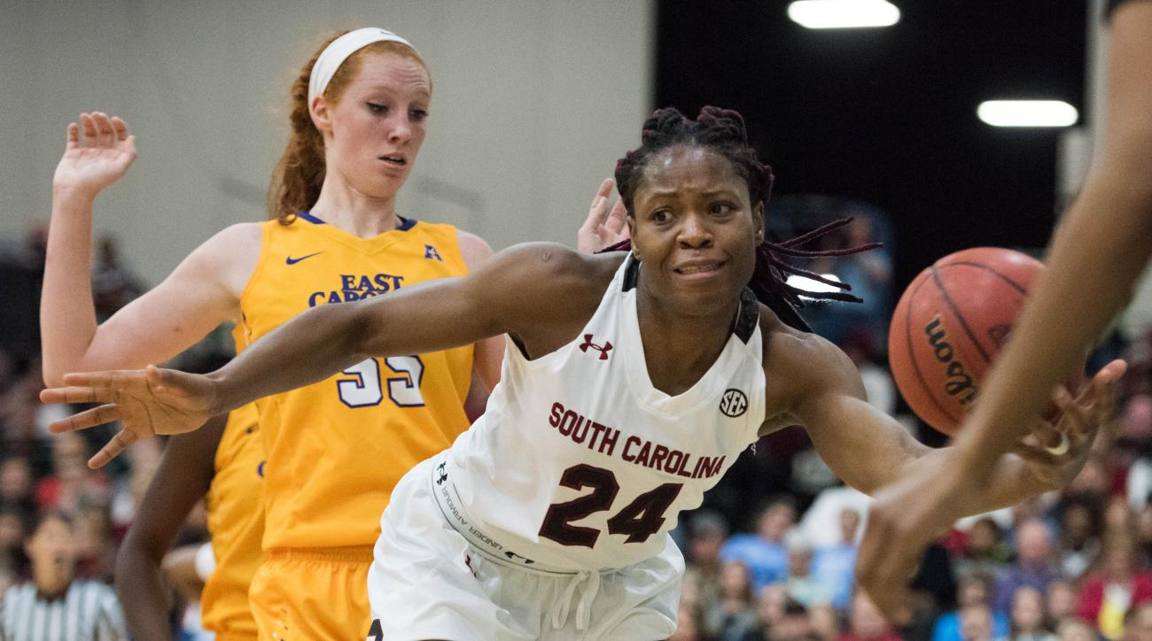 South Carolina forward Sarah Imovbioh (24) goes for a loose ball against East Carolina forward Marina Laramie, left, during the first half of an NCAA college basketball game on Sunday, Dec. 20, 2015, in Myrtle Beach, S.C. (AP Photo/Sean Rayford)