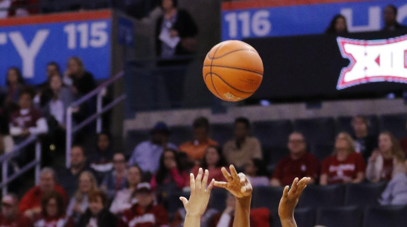 Arkansas forward Jessica Jackson (00) shoots over Texas forward Jordan Hosey (5) during the third quarter of an NCAA college basketball game in Oklahoma City, Sunday, Dec. 20, 2015. Texas won 61-50. (AP Photo/Alonzo Adams)