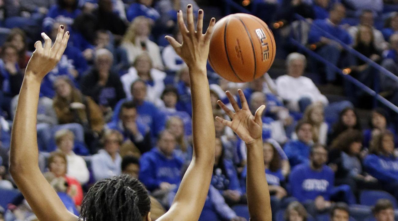 Kentucky's Taylor Murray, right, shoots under pressure from Duke's Azura Stevens during an NCAA college basketball game, Sunday, Dec. 20, 2015, in Lexington, Ky. (AP Photo/James Crisp)