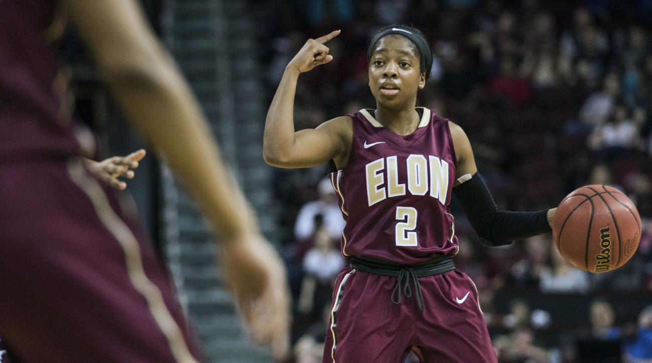 Elon guard Essence Baucom communicates with teammates during the first half of an NCAA college basketball game  against South Carolina, on Tuesday, Dec. 22, 2015, in Columbia, S.C. (AP Photo/Sean Rayford)