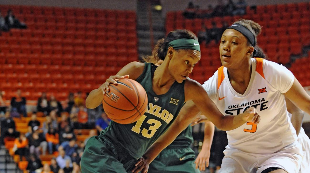 Baylor forward Nina Davis (13) drives past Oklahoma State center Mandy Coleman in the first half of an NCAA college basketball game in Stillwater, Okla., Wednesday, Dec. 30, 2015. (AP Photo/Brody Schmidt)