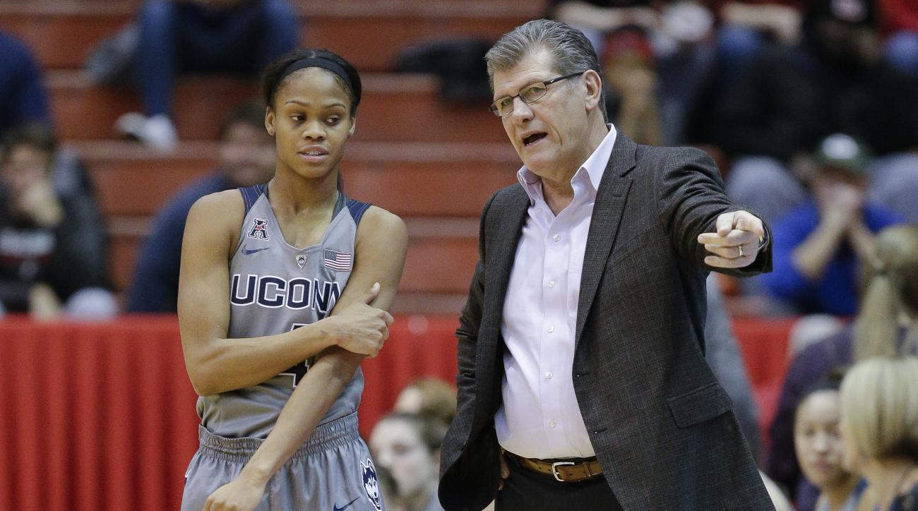 Connecticut coach Geno Auriemma, right, speaks with Moriah Jefferson (4) in the first half of an NCAA college basketball game against Cincinnati, Wednesday, Dec. 30, 2015, in Cincinnati. (AP Photo/John Minchillo)