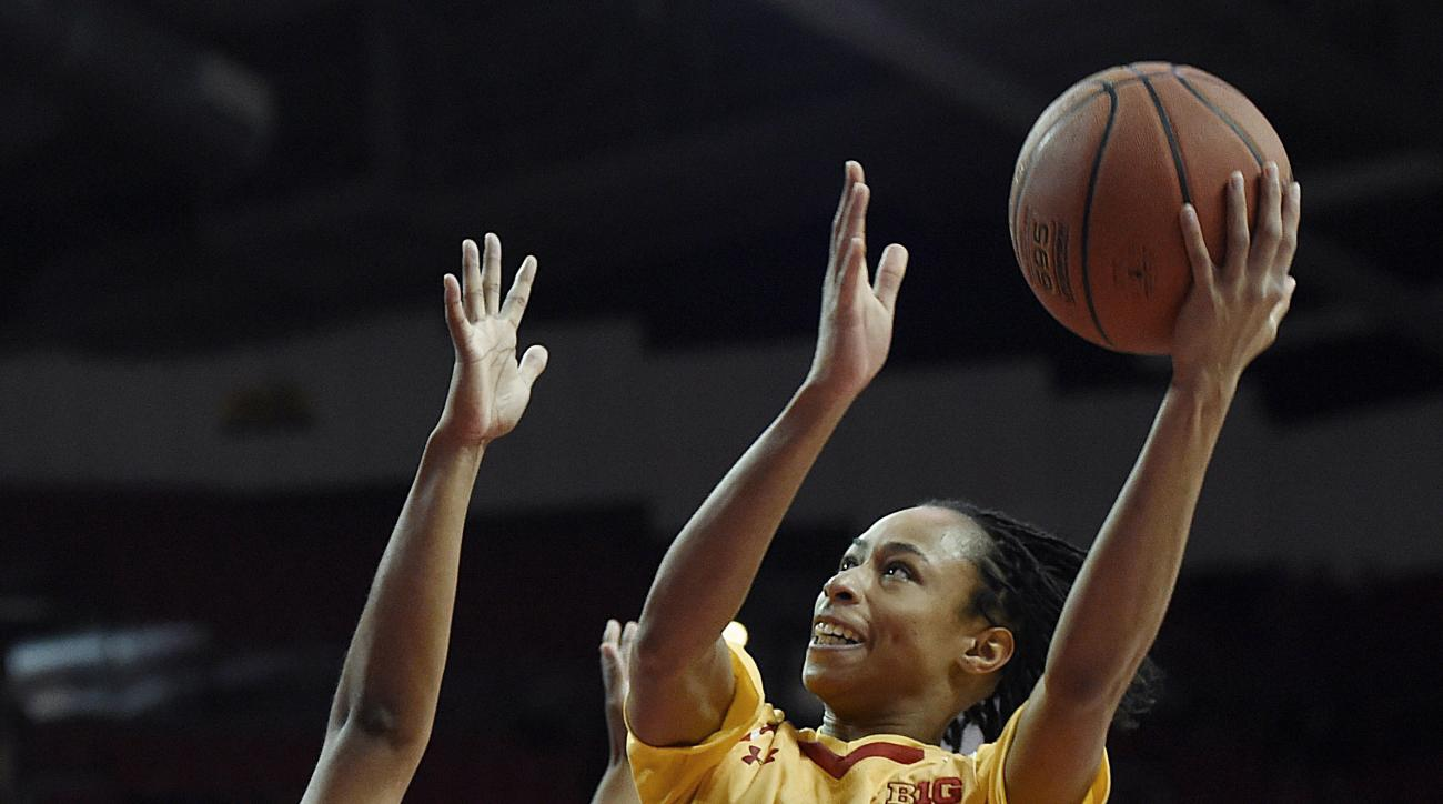 Maryland's Brene Moseley, right, shoots over Ohio State's Asia Doss, center, during the first half of an NCAA college basketball game, Saturday, Jan. 2, 2016, in College Park, Md. (AP Photo/Gail Burton)