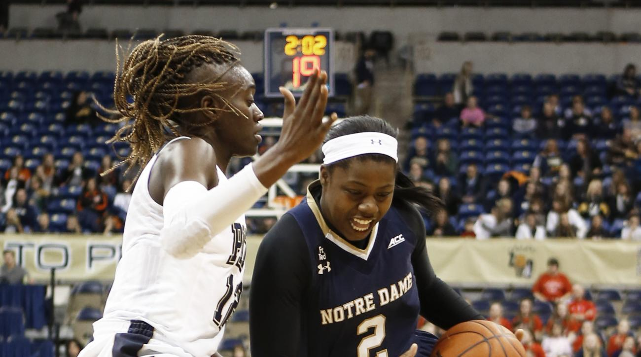 Notre Dame's Arike Ogunbowale (2) drives past Pittsburgh's Yacine Diop (12) during the first half of an NCAA college basketball game, Sunday, Jan. 3, 2016, in Pittsburgh. (AP Photo/Keith Srakocic)