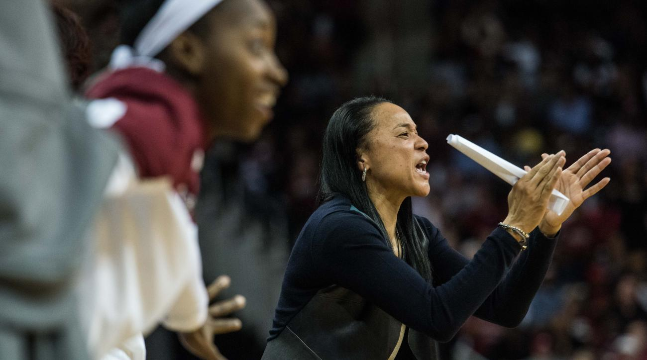 South Carolina head coach Dawn Staley communicates with her team against Arkansas during the first half of an NCAA college basketball game on Sunday, Jan. 3, 2016, in Columbia, S.C. (AP Photo/Sean Rayford)
