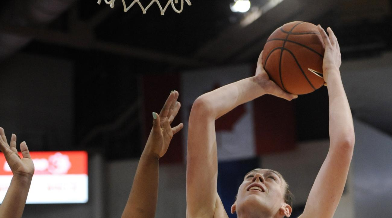 Connecticut's Breanna Stewart, right, shoots over Tulsa's Crystal Polk, left, in the first half of an NCAA college basketball game, Wednesday, Jan. 6, 2016, in Hartford, Conn. (AP Photo/Jessica Hill)