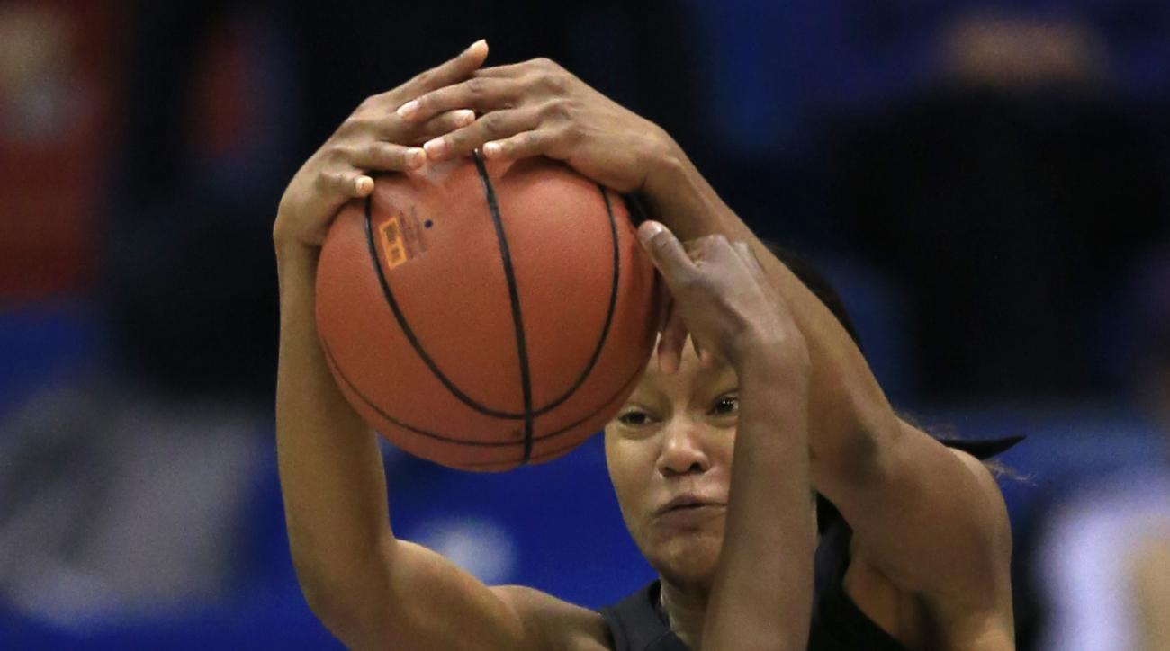 Baylor forward Nina Davis (13) blocks a shot by Kansas guard Chayla Cheadle (22) during the second half of an NCAA college basketball game in Lawrence, Kan., Wednesday, Jan. 6, 2016. (AP Photo/Orlin Wagner)