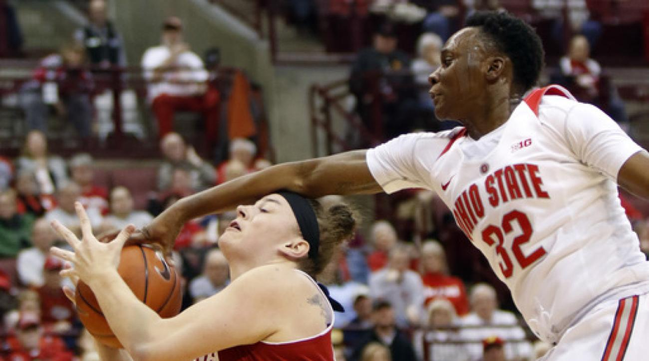 Ohio State's Shayla Cooper, right, reaches for the ball against Indiana's Jenn Anderson during the first half of an NCAA college basketball game in Columbus, Ohio, Thursday, Jan. 7, 2016. (AP Photo/Paul Vernon)