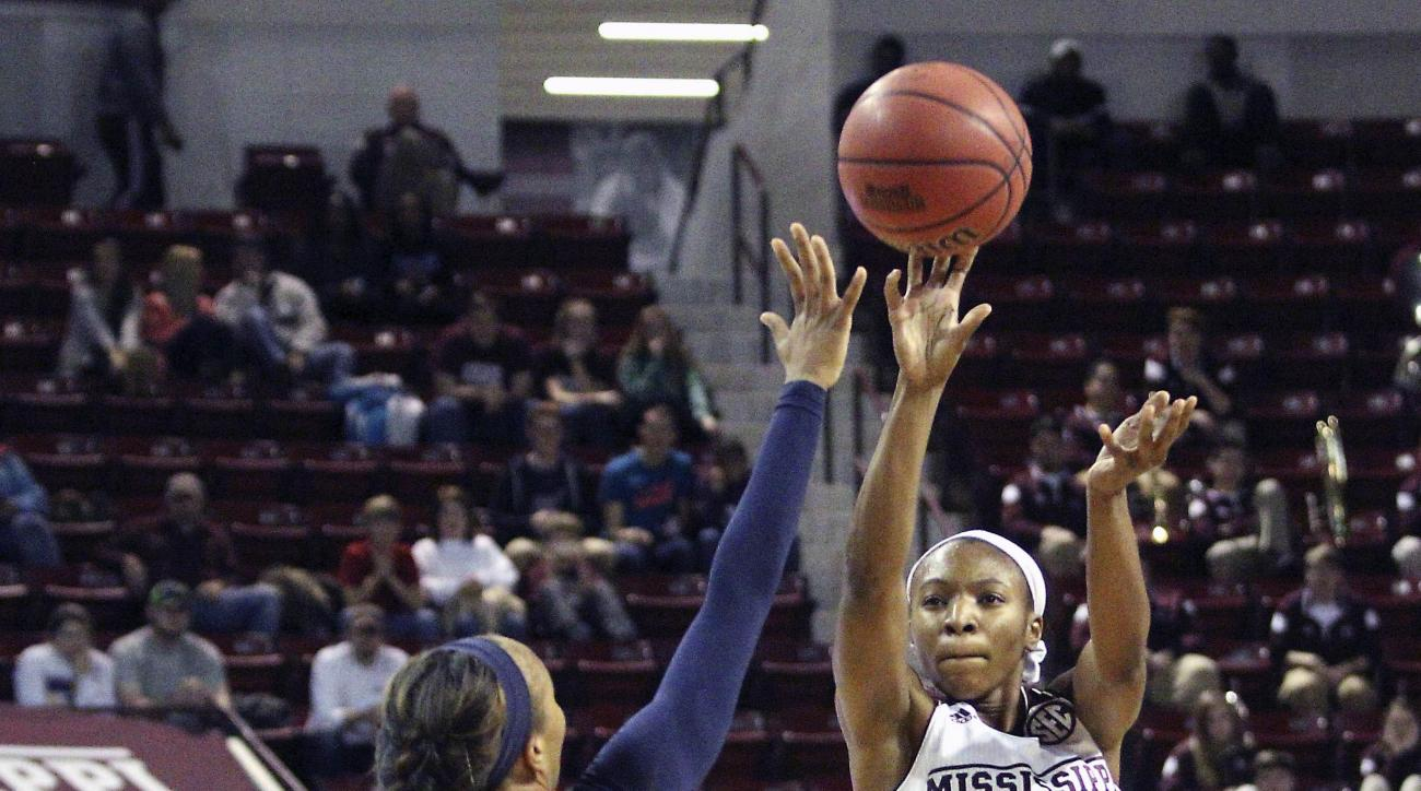 Mississippi State guard Morgan William (2) shoots a 3-point-shot over the outstretched arm of Auburn guard Brandy Montgomery (10) during the first half of an NCAA college basketball game in Starkville, Miss., Thursday, Jan. 7, 2016. (AP Photo/Jim Lytle)