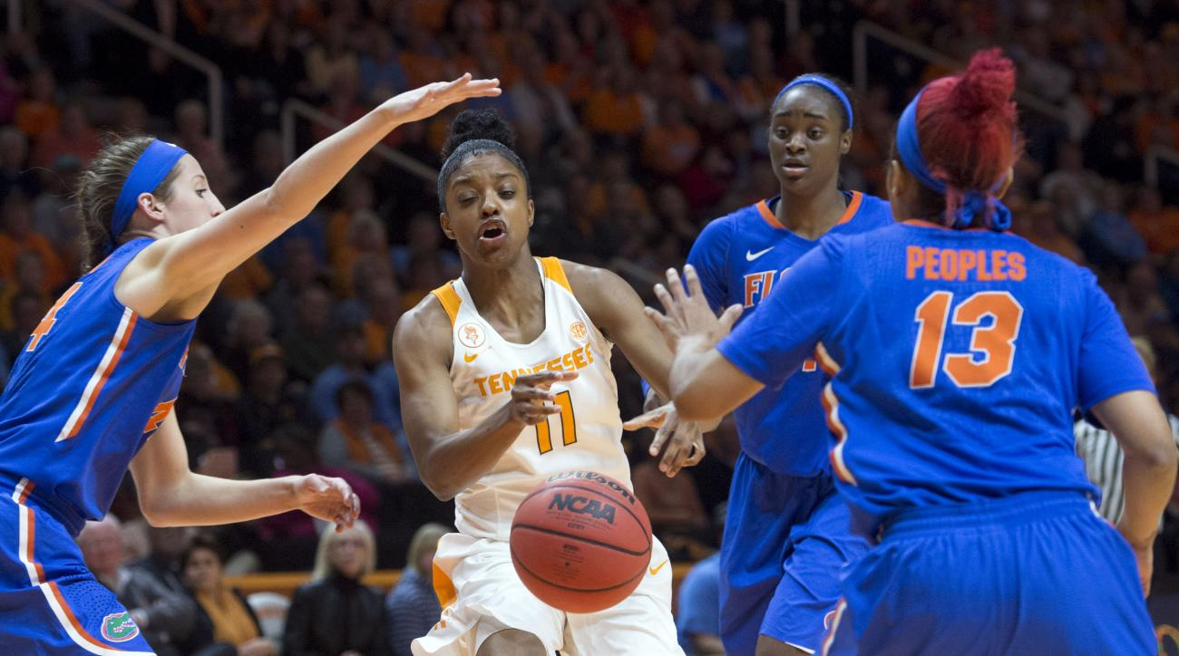 Tennessee's Diamond DeShields loses the ball as she comes up against Florida defenders, from left, Haley Lorenzen, Ronni Williams, and Cassie Peoples during an NCAA college basketball game in Knoxville, Tenn., on Thursday, Jan. 7, 2016. Florida beat Tenne
